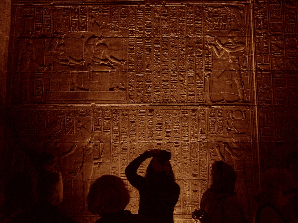 Tourist photographing the Temple of Philae in Aswan, Egypt.