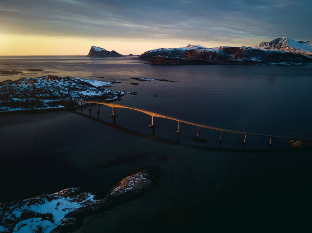 According to CNN, a bridge across to Sommarøy is covered in wrist watches, a symbol for visitors to leave time behind.