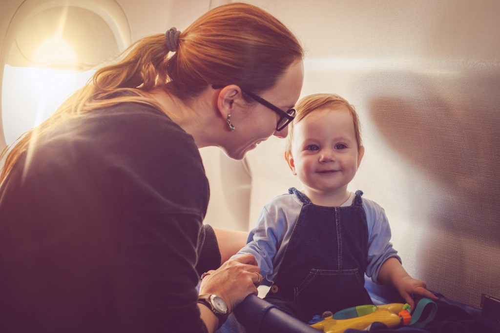 Woman traveling with her baby in plane