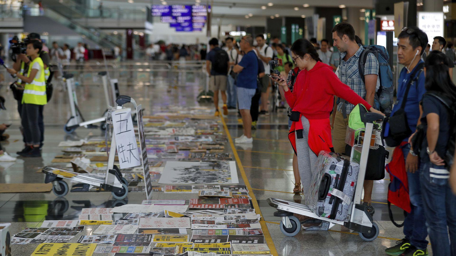 Flights resume as Hong Kong airport shuts out protesters