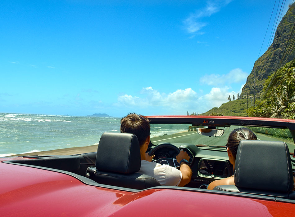 Couple driving in Hawaii