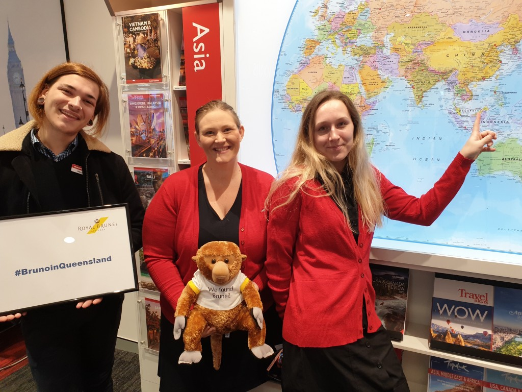 Michael Gehrke, Kathryn McClean and Tamika Lanham (Flight Centre Tailor Made at Mt Ommaney) with Bruno the monkey