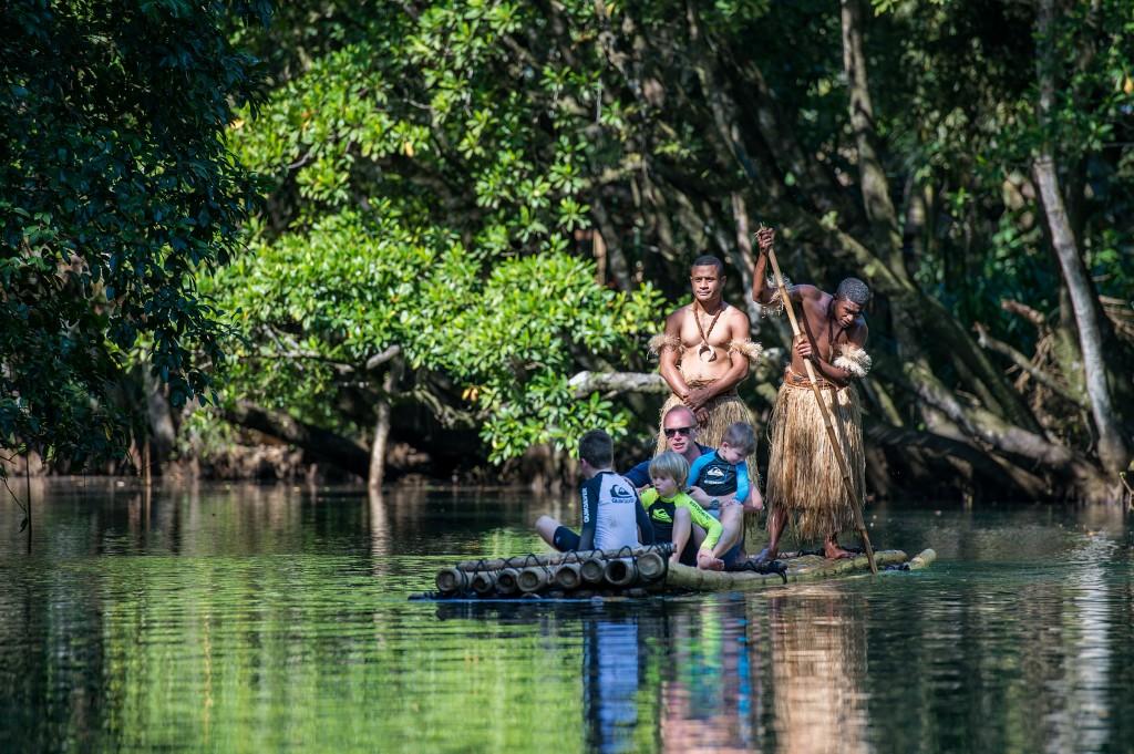 Nanuku family rafting down river