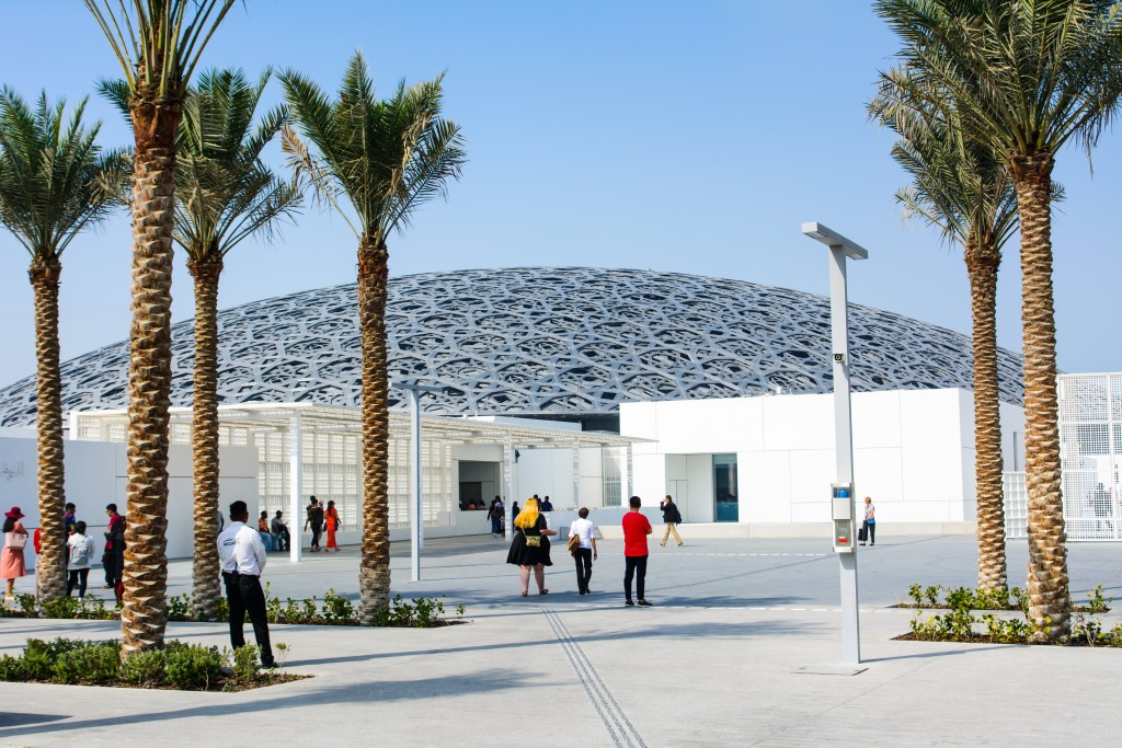 Louvre Abu Dhabi building exterior on a sunny day