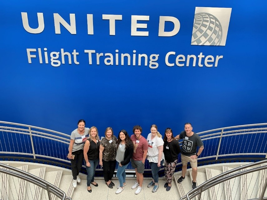 Pictured at United Flight Training Centre (L-R): Carolyn Nightingale – Colorado Tourism; Belinda Condon – United Airlines; Helen Koroneos – Helloworld Travel Niddrie; Sarah De Vries – Helloworld Travel Bonnyrigg; Brad Standen – Hunter Travel Group; Stacey Skinner – Helloworld Travel Warrnambool; Rachelle Evans – Eastern Hill Travel; Craig Pearce – Figtree Travel